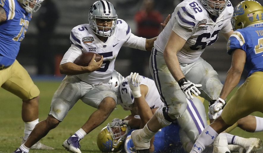 FILE - In this Dec. 26, 2017, file photo, Kansas State quarterback Alex Delton (5) runs with the ball in the second half during an NCAA college football bowl game against UCLA in Phoenix. Bill Snyder's record as a head coach is marvelous when he has a returning quarterback with big-game experience, and that should bode especially well for Kansas State this season. That's because he has two of them.  (AP Photo/Rick Scuteri, File)