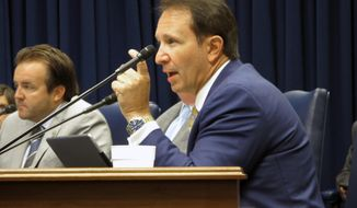 Attorney General Jeff Landry speaks during a Bond Commission hearing, Thursday, Aug. 16, 2018, in Baton Rouge, La. Landry supported a commission decision to block two banks from involvement in a $600 million road financing plan because they have policies restricting gun sales. (AP Photo/Melinda Deslatte)