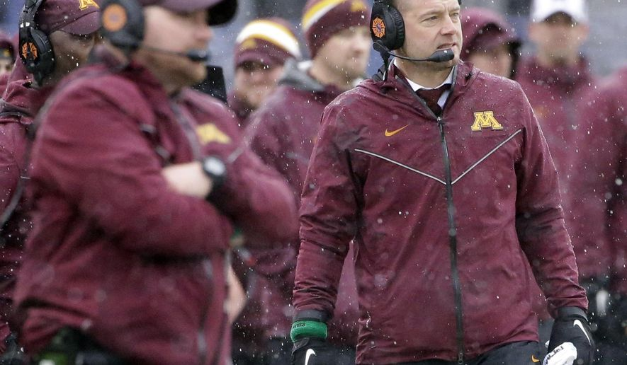 File-This Nov. 18, 2018, file photo shows Minnesota head coach P.J. Fleck reacting as he watches his team against Northwestern during the first half of an NCAA college football game in Evanston, Ill. After scoring became a struggle down the stretch of head coach Fleck's first season at Minnesota, the Gophers face another uphill climb on offense with a quarterback, either Tanner Morgan or Zack Annexstad, who has yet to take a snap in a college game. (AP Photo/Nam Y. Huh, File)