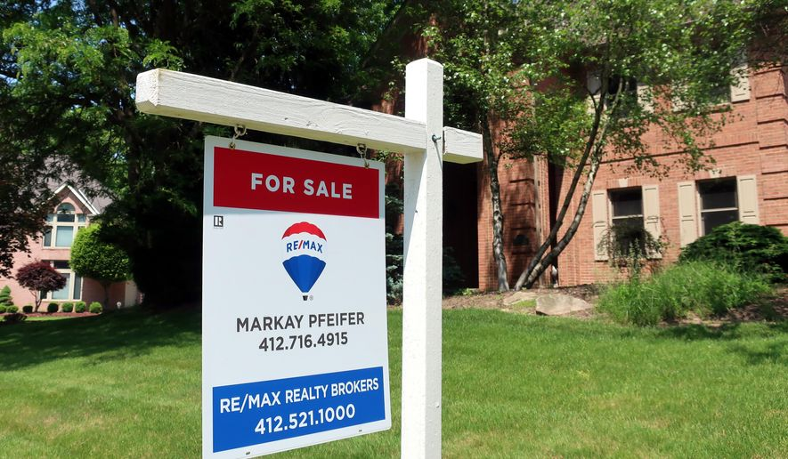 This May 26, 2018, photo shows a home for sale in Gibsonia, Pa. On Thursday, Aug. 16, Freddie Mac reports on the week's average U.S. mortgage rates. (AP Photo/Ted Shaffrey)