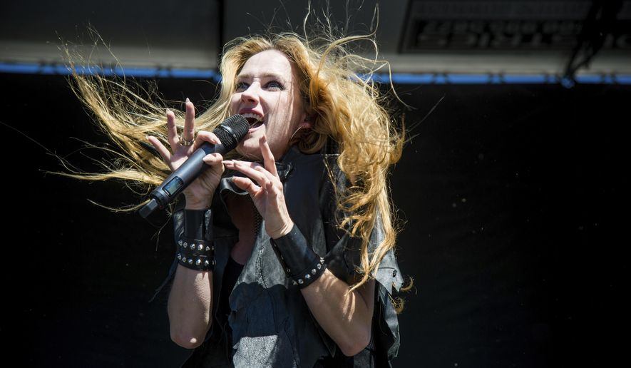 FILE - In this Sept. 24, 2016 file photo, Jill Janus of Huntress performs at Ozzfest 2016 at San Manuel Amphitheater in San Bernardino, Calif. Janus, lead singer of the heavy metal band Huntress, has died at age 43. A statement from Janus' bandmates and family released Thursday, Aug. 16, 2018, through publicist Alexandra Greenberg said Janus had long struggled with mental illness, and killed herself outside Portland, Ore., on Tuesday, Aug. 14. (Amy Harris/Invision/AP, File)