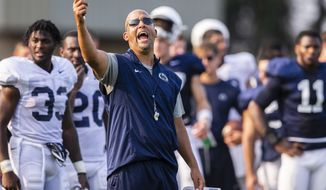 Penn State head coach James Franklin yells during an NCAA college football practice, Wednesday, Aug. 15, 2018, in State College, Pa. (Joe Hermitt/The Patriot-News via AP)