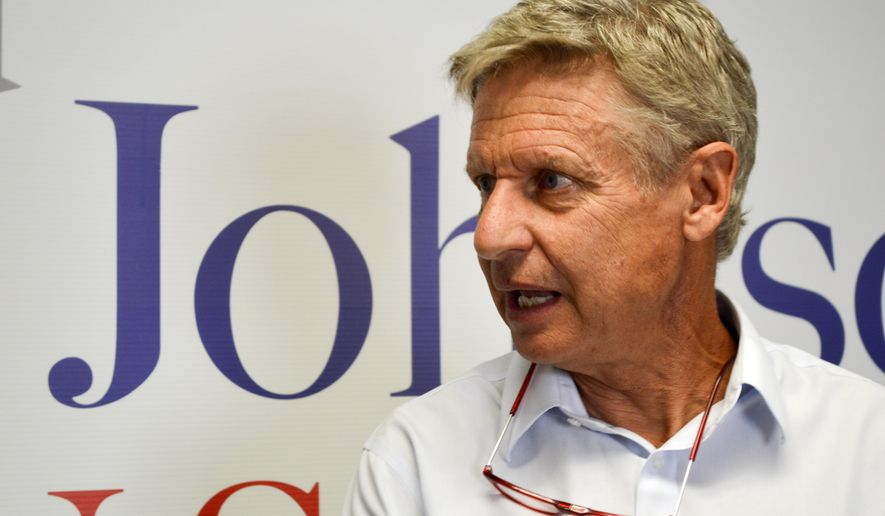 Former Libertarian presidential candidate Gary Johnson talks to reporters on Thursday, Aug. 16, 2018, about his decision to join the U.S. Senate race in New Mexico. (AP Photo/ Russell Contreras)