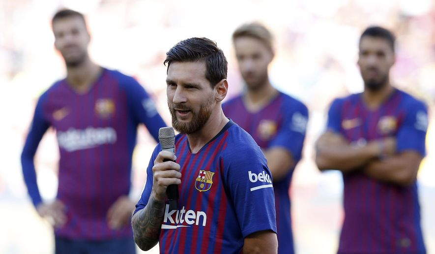 FC Barcelona's Lionel Messi talks to the crowd ahead of the Joan Gamper trophy friendly soccer match between FC Barcelona and Boca Juniors at the Camp Nou stadium in Barcelona, Spain, Wednesday, Aug. 15, 2018. (AP Photo/Manu Fernandez)