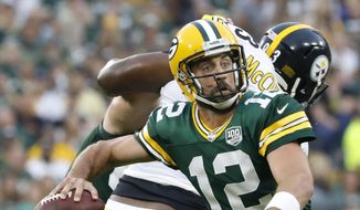 Green Bay Packers' Aaron Rodgers throws during the first half of a preseason NFL football game against the Pittsburgh Steelers Thursday, Aug. 16, 2018, in Green Bay, Wis. (AP Photo/Jeffrey Phelps) ** FILE **