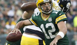 Green Bay Packers' Aaron Rodgers throws during the first half of a preseason NFL football game against the Pittsburgh Steelers Thursday, Aug. 16, 2018, in Green Bay, Wis. (AP Photo/Jeffrey Phelps)