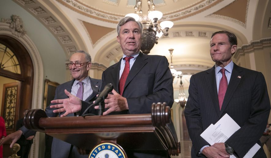 Sen. Sheldon Whitehouse, D-R.I., flanked by Senate Minority Leader Chuck Schumer, D-N.Y., left, and by Sen. Richard Blumenthal, D-Conn., speaks to reporters during a news conference on Capitol Hill in Washington, Thursday, Aug. 16, 2018. (AP Photo/J. Scott Applewhite) ** FILE **