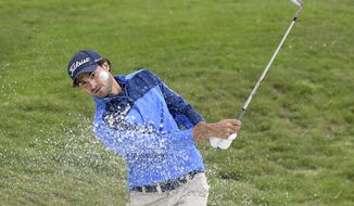 Clement Sordet of France watches his bunker shot on 18th hole during the first round of Nordea Masters at Hills Golf Club, Gothenburg, Sweden, Thursday Aug. 16, 2018. (Anders Wiklund/TT via AP)