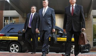Defense attorneys Richard Westling, left, Kevin Downing, and Thomas Zehnle, walk to federal court as jury deliberations begin in the trial of former Trump campaign chairman Paul Manafort, in Alexandria, Va., Thursday, Aug. 16, 2018. (AP Photo/Jacquelyn Martin)