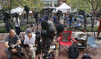 Members of the media as set up outside of federal court as jury deliberations are set to begin in the trial of former Trump campaign chairman Paul Manafort, in Alexandria, Va., Thursday, Aug. 16, 2018. (AP Photo/Jacquelyn Martin)