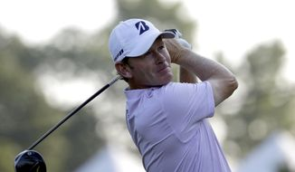 Brandt Snedeker watches his tee shot on the 11th hole during the first round of the Wyndham Championship golf tournament in Greensboro, N.C., Thursday, Aug. 16, 2018. (AP Photo/Chuck Burton)