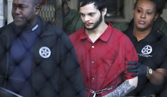 FILE - In this Jan. 30, 2017, file photo, Esteban Santiago, center, is led from the Broward County jail for an arraignment in federal court in Fort Lauderdale, Fla. Sentencing is set Friday, Aug. 17, 2018, for Santiago, a 28-year-old Alaska man who pleaded guilty in the January 2017 Florida airport shooting that left five people dead and six wounded. (AP Photo/Lynne Sladky, File)