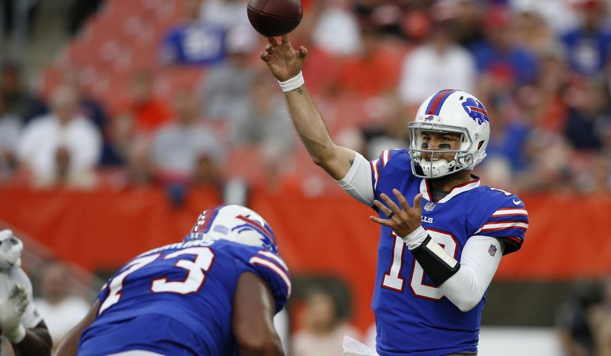 Buffalo Bills quarterback AJ McCarron throws during the first half of the team's NFL football preseason game against the Cleveland Browns, Friday, Aug. 17, 2018, in Cleveland. (AP Photo/Ron Schwane)