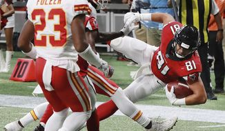 Atlanta Falcons tight end Austin Hooper catches a pass from Matt Ryan and goes over the top past a pair of Kansas City Chiefs defenders into the end zone during the first quarter of an NFL preseason football game Friday, Aug, 17, 2018, in Atlanta. (Curtis Compton/Atlanta Journal-Constitution via AP)