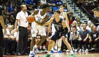 Duke's R.J. Barrett (5) goes up against Toronto's Inaki Alvarez (3) during a college basketball exhibition game in Mississauga, Ontario, Friday, Aug. 17, 2018. (Christopher Katsarov/The Canadian Press via AP)