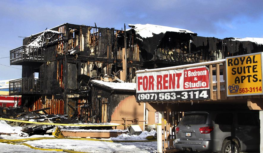 FILE - In this Feb. 15, 2017 file photo the burned remains of the Royal Suite Lodge in Anchorage, Alaska, are shown after an early morning fire. An Alaska grand jury has indicted two people suspected of causing the fire that killed three people and injured others. Anchorage District Attorney Rick Allen announced Friday, Aug. 17, 2018, that 29-year-old Carleigh Fox and 30-year-old Andrew Eknaty were indicted on counts of second-degree murder, manslaughter, felony assault and arson. They're also charged with assault on an unborn child, conspiracy, evidence tampering and failure to control a dangerous fire. (AP Photo/Mark Thiessen, File)