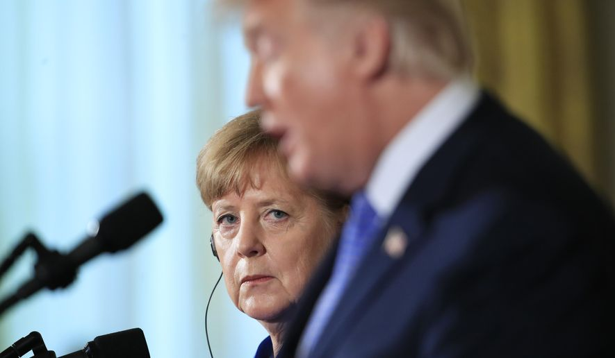 German Chancellor Angela Merkel listens to President Donald Trump talk during a news conference in the East Room of the White House in Washington, April 27, 2018. (AP Photo/Manuel Balce Ceneta) ** FILE **