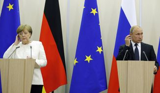 FILE - In this May 18, 2018 file photo Russian President Vladimir Putin, right, and German Chancellor Angela Merkel attend news conference after their meeting at Putin's residence in the Russian Black Sea resort of Sochi, Russia. Merkel and Putin will meet on Saturday in the German government's guesthouse Meseberg, north of Berlin, Saturday, Aug. 18, 2018. The topics will include the civil war in Syria, the conflict in Ukraine, and energy questions. (AP Photo/Alexander Zemlianichenko, file)