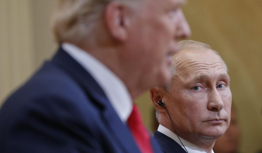 In this July 16, 2018, file photo Russian President Vladimir Putin, right, looks over towards U.S. President Donald Trump, left, as Trump speaks during their joint news conference at the Presidential Palace in Helsinki, Finland. Merkel and Putin will meet on Saturday in the German government's guesthouse Meseberg, north of Berlin, Saturday, Aug. 18, 2018. The topics will include the civil war in Syria, the conflict in Ukraine, and energy questions. (AP Photo/Pablo Martinez Monsivais, file)