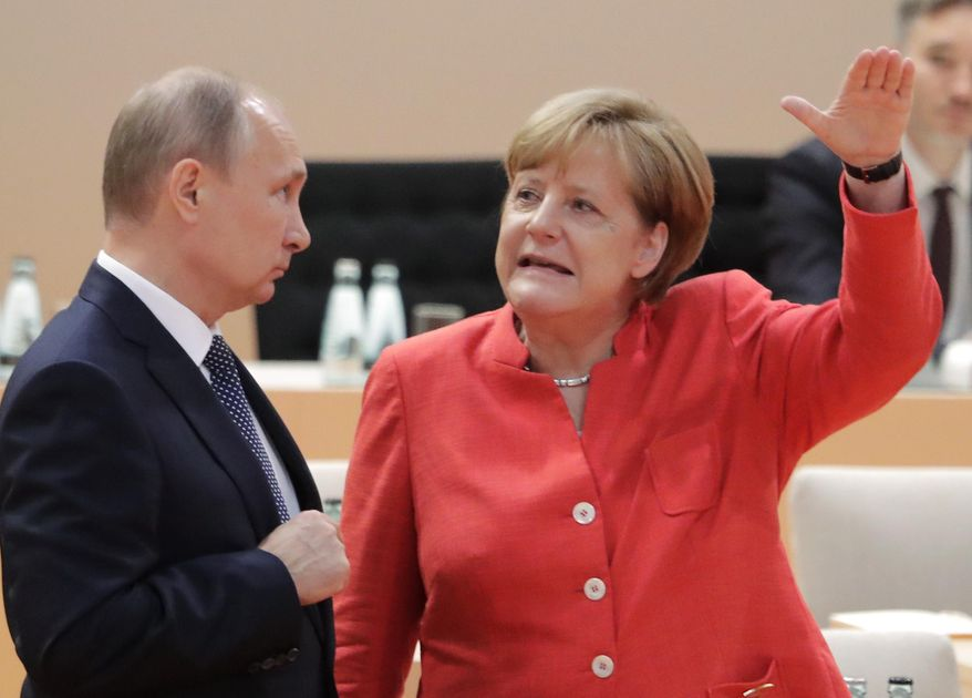 FILE - In this July 7, 2017 file photo Russian President Vladimir Putin, left, talks with German Chancellor Angela Merkel prior to the first working session on the first day of the G-20 summit in Hamburg, northern Germany. Merkel and Putin will meet on Saturday in the German government's guesthouse Meseberg, north of Berlin, Saturday, Aug. 18, 2018. The topics will include the civil war in Syria, the conflict in Ukraine, and energy questions. (AP Photo/Markus Schreiber, file)