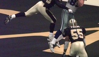 FILE - In this Dec. 24, 1999, file photo, New Orleans Saints linebacker Keith Mitchell (59) deflects a pass away Dallas Cowboys tightend David LaFleur (89) during the fourth quarter in New Orleans. Mitchell deflected the ball to teammate Mark Fields (55) who intercepted the pass, sealing the Saints 31-24 victory. On a routine tackle on Sept. 14, 2003, Keith Mitchell wound up flat on his back unable to move. His playing career was over. He had a spinal contusion. Now Mitchell is a certified yoga instructor with more than a decade of experience. He founded the Light It Up Foundation and the KM59 wellness movement that helps children, trauma survivors, first responders and veterans.  (AP Photo/Bill Haber, File)