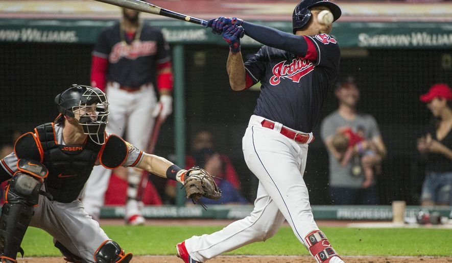 Cleveland Indians' Jose Ramirez, right, fouls off a pitch from Baltimore Orioles starting pitcher David Hess as catcher Caleb Joseph watches during the fifth inning of a baseball game in Cleveland, Friday, Aug. 17, 2018. (AP Photo/Phil Long)