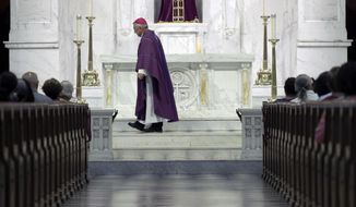 Bishop Ronald Gainer, of the Harrisburg Diocese, walks past the altar as he celebrates mass at the Cathedral Church of Saint Patrick in Harrisburg, Pa., Friday, Aug. 17, 2018.  The grand jury report released this week found rampant sexual abuse of more than 1,000 children by about 300 priests in six Pennsylvania dioceses over seven decades. It criticized Gainer for advocating to the Vatican that two abusive priests not be defrocked.  (AP Photo/Matt Rourke)