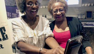 Gwendolyn Fuller Mukes, left, and Marilyn Luper Hildreth pose for a selfie at the Oklahoma History Center in Oklahoma City on Friday, Aug. 17, 2018. Both received the Tulsa-based Woody Guthrie Center's Oklahoma Changing World Prize for their roles in an Aug. 19, 1958, sit-in at an Oklahoma City drug store that ushered in the civil rights movement in the state. (AP Photo/Adam Kealoha Causey)