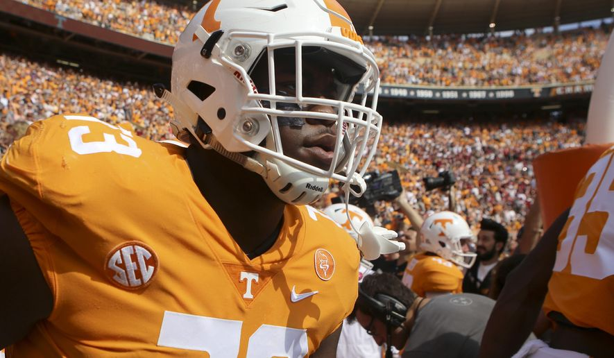 FILE - In this Oct. 14, 2017, file photo, Tennessee offensive lineman Trey Smith (73) makes his way onto the field for the Volunteers' game against South Carolina at Neyland Stadium in Knoxville, Tenn. Tennessee is counting on some reinforcements to help rebuild an offensive line that was devastated by injuries and defections last season. The Volunteers could use an immediate contribution from Alabama graduate transfer Brandon Kennedy, a successful comeback from Chance Hall and a full season from Trey Smith after he missed spring practice with blood clots in his lungs.(C.B. Schmelter/Chattanooga Times Free Press via AP, File)/Chattanooga Times Free Press via AP)