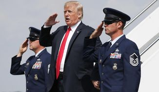 President Donald Trump salutes on his arrival on Air Force One at Morristown Municipal Airport in Morristown, N.J., Friday, Aug. 17, 2018, en route to Trump National Golf Club in Bedminster, N.J. (AP Photo/Pablo Martinez Monsivais)