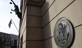 Federal court is seen as the second day of jury deliberations begin in the trial of former Trump campaign chairman Paul Manafort, in Alexandria, Va., Friday, Aug. 17, 2018. (AP Photo/Jacquelyn Martin)