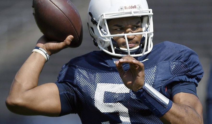 FILE - In this April 14, 2018, file photo, quarterback David Pindell warms up before Connecticut's annual spring NCAA college football game in East Hartford, Conn. UConn will host Central Florida to open the regular season on Thursday night, Aug. 30. (AP Photo/Jessica Hill, File)