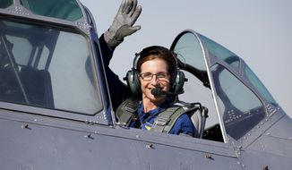 FILE - In this Jan. 12, 2018, file photo, Rep. Martha McSally, R-Ariz., leaves in a T-6 World War II airplane after speaking at a rally in Phoenix. Women with military experience _ many of them combat veterans _ are among the record number of female candidates running for office this year.  (AP Photo/Matt York)