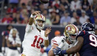 San Francisco 49ers quarterback Jimmy Garoppolo (10) throws a pass against the Houston Texans during the first half of an NFL preseason football game Saturday, Aug. 18, 2018, in Houston. (AP Photo/Eric Christian Smith)