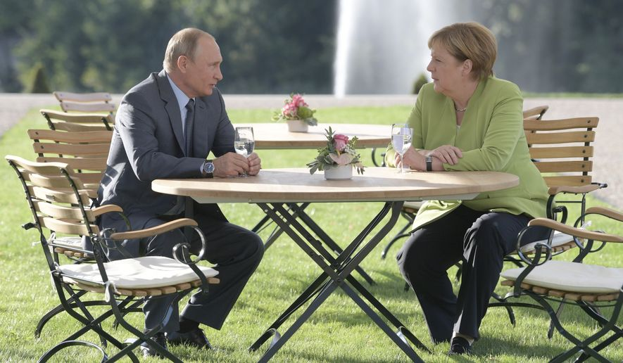 German Chancellor Angela Merkel's meeting this month with Russian President Vladimir Putin — their second since May — should not be construed as bowing to Moscow's will, despite a determination by both sides to continue with the energy project, analysts say. (Associated Press/File)
