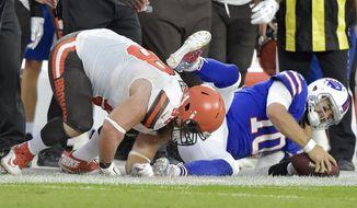 Cleveland Browns defensive tackle Jamie Meder (98) tackles Buffalo Bills quarterback AJ McCarron (10) during the first half of an NFL football preseason game Friday, Aug. 17, 2018, in Cleveland. The Bills won 19-17. (AP Photo/David Richard)