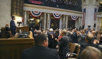 In this Jan 24, 2018, photo provided by the Wisconsin Center for Investigative Journalism, Wisconsin Gov. Scott Walker delivers his state of the state address at the state Capitol in Madison. An investigation by the Wisconsin Center for Investigative Journalism has found that since Walker was elected, the length of time bills are deliberated in the Wisconsin Legislature dropped significantly as lawmakers increasingly fast-tracked bills. (Coburn Dukehart/Wisconsin Center for Investigative Journalism via AP)