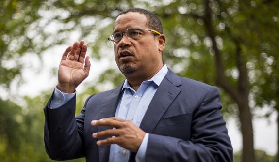 Rep. Keith Ellison addresses his campaign volunteers and supporters before sending them off on a door knocking campaign, Friday, Aug. 17, 2018, in Minneapolis. Minnesota Rep. Keith Ellison said Friday he won't abandon his campaign for attorney general amid allegations that he once physically abused an ex-girlfriend and said if she claims to have a video of the incident she should produce it. (Alex Kormann/Star Tribune via AP) ** FILE **