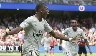 PSG's Kylian Mbappe celebrates after scoring the second goal for his team during their League One soccer match between Guingamp and Paris Saint Germain at Roudourou stadium in Guingamp, western France, Saturday, Aug. 18, 2018. (AP Photo)
