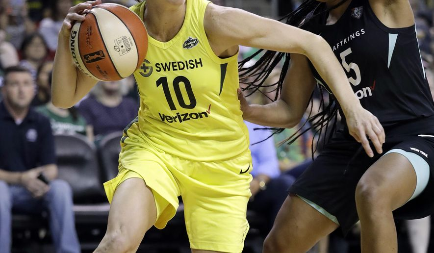 Seattle Storm's Sue Bird (10) tries to get past New York Liberty's Brittany Boyd during the first of a WNBA basketball game Friday, Aug. 17, 2018, in Seattle. (AP Photo/Elaine Thompson)