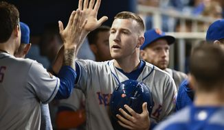 FILE - In this July 1, 2018 file photo New York Mets third baseman Todd Frazier celebrates with teammates after scoring during the second inning of a baseball game against the Miami Marlins in Miami. Some talented, young baseball players have competed at the Little League World Series over the last 71 years. Fifty-four have gone on to realize another dream _ making the majors. Frazier will be one of the three Little League veterans on hand when the Mets play the Phillies in central Pennsylvania on Sunday, Aug. 19, 2018. (AP Photo/Gaston De Cardenas)