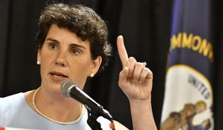 """Amy McGrath, a Kentucky Democratic candidate for Congress, speaks to supporters during the 26th Annual Wendell Ford Dinner, Saturday, Aug. 18, 2018, in Louisville, Ky. The former fighter pilot said that her military service would help her """"cut through"""" the political discord dividing Washington if she's elected to Congress. (AP Photo/Timothy D. Easley) ** FILE **"""