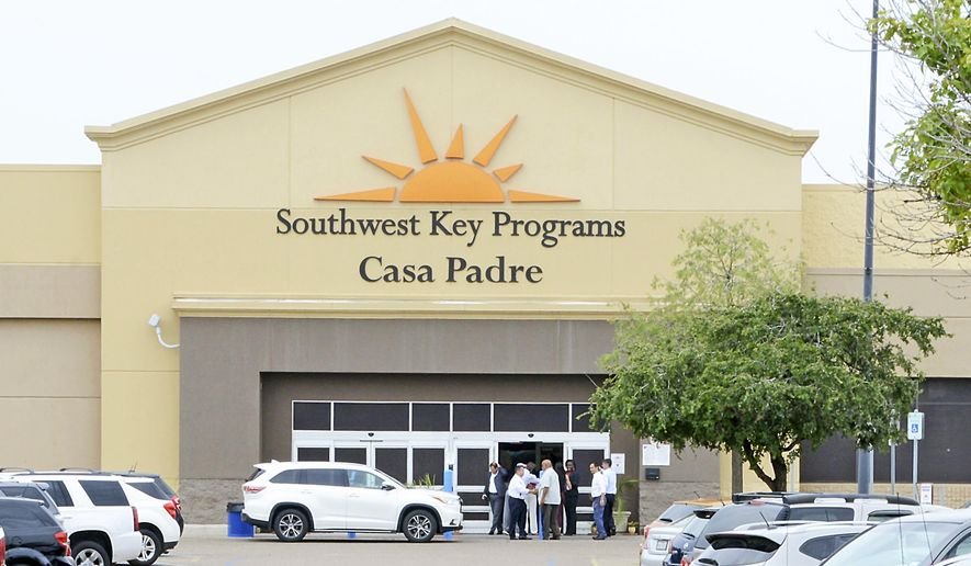 In this June 18, 2018, file photo, dignitaries take a tour of Southwest Key Programs Casa Padre, a U.S. immigration facility in Brownsville, Texas, where children are detained. When school leaders in San Benito, Texas, learned of an influx of children to a migrant shelter in town, they felt obliged to help. The superintendent reached out and agreed to send 19 bilingual teachers and hundreds of computers to make the learning environment as similar as possible to one of his schools. (Miguel Roberts/The Brownsville Herald via AP, File)