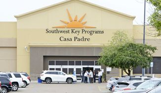 FILE - In this June 18, 2018, file photo, dignitaries take a tour of Southwest Key Programs Casa Padre, a U.S. immigration facility in Brownsville, Texas, where children are detained. When school leaders in San Benito, Texas, learned of an influx of children to a migrant shelter in town, they felt obliged to help. The superintendent reached out and agreed to send 19 bilingual teachers and hundreds of computers to make the learning environment as similar as possible to one of his schools. (Miguel Roberts/The Brownsville Herald via AP, File)