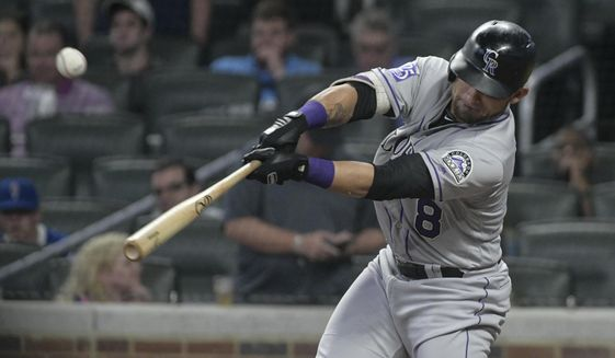 Colorado Rockies' Gerardo Parra hits a line drive single to left field for an RBI against the Atlanta Braves during the ninth inning of a baseball game Saturday, Aug. 18, 2018, in Atlanta. (AP Photo/John Amis) ** FILE **