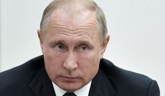 Russian President Vladimir Putin chairs a Security Council meeting in Moscow, Russia, Friday, Aug. 17, 2018. (Alexei Nikolsky, Sputnik, Kremlin Pool Photo via AP) ** FILE **