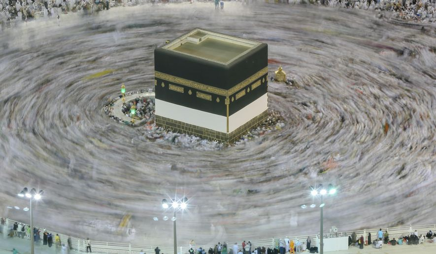 Muslim pilgrims circle around the Kaaba, the cubic building at the Grand Mosque, ahead of the annual Hajj pilgrimage, in the Muslim holy city of Mecca, Saudi Arabia, early Friday, Aug. 17, 2018. The annual Islamic pilgrimage draws millions of visitors each year, making it the largest yearly gathering of people in the world. (AP Photo/Dar Yasin)