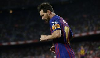 FC Barcelona's Lionel Messi looks down during the Spanish La Liga soccer match between FC Barcelona and Alaves at the Camp Nou stadium in Barcelona, Spain, Saturday, Aug. 18, 2018. (AP Photo/Manu Fernandez)