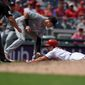 The Washington Nationals' Adam Eaton is tagged out by Miami Marlins third baseman Brian Anderson trying to stretch a double into a triple in the third inning on Sunday. Eaton's double was one of just two extra-base hits managed by the Nationals in the loss. (Associated Press)
