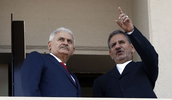 Iran's Senior Vice President Eshaq Jahangiri, right, and Turkey's Prime Minister Binali Yildirim look towards the city center from the balcony of Yildirim's office in Ankara, Turkey, Thursday, Oct. 19, 2017. Jahangiri is visiting Turkey to attend a regional cooperation meeting in Istanbul. (AP Photo/Burhan Ozbilici)